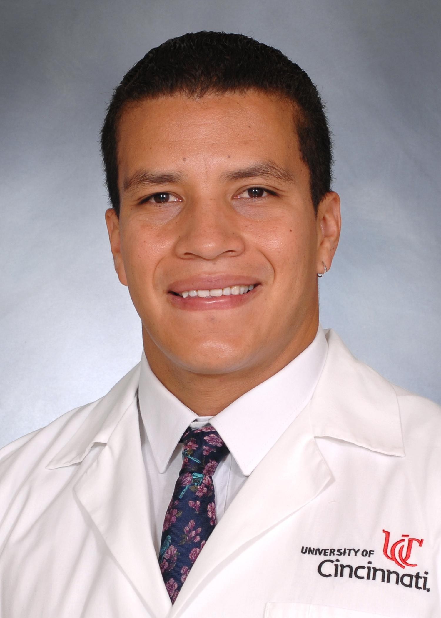 FeriaGarzon Manuel with UC lab coat