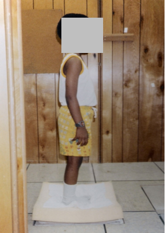 A child standing on a foam pad measuring postural balance
