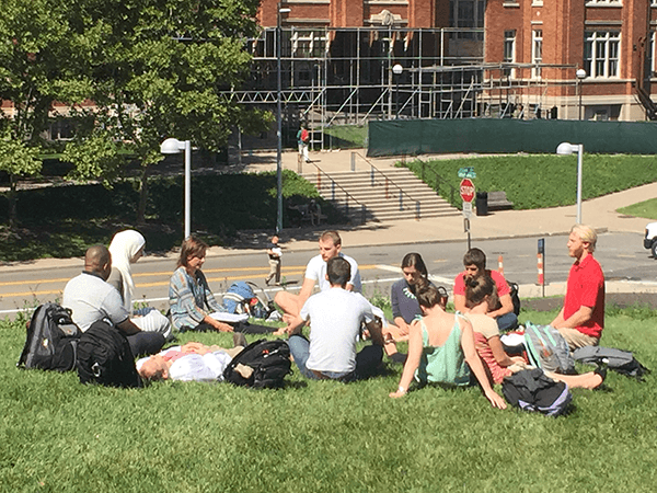 students gather to rest in a circle